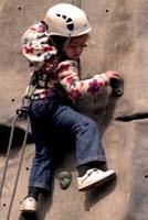 Ruby tackles a climbing wall.