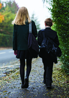 Kieran, pictured with sister Lauren, missed eight months of school due to cancer treatment.
