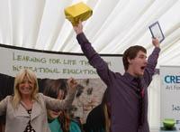 A 2012 winner, Luke Tuckwell, receives his award from Gaby Roslin.